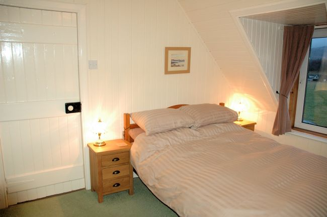 The bedrooms have pine-lined walls and ceilings and are cosy and welcoming. There are superb views from the bedroom windows.