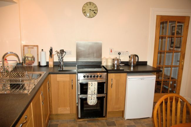 The kitchen in Bruaich Cottage has recently been re-fitted to a high standard with modern kitchen units and appliances.