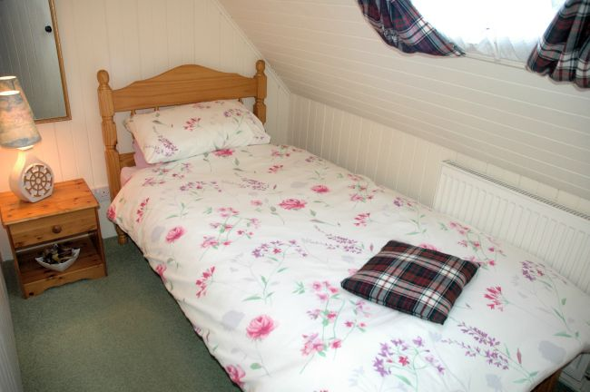The single bedroom in Bruaich Cottage, Lochcarron, is small but comfortable and has a full-size single bed.